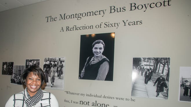 Felicia A. Bell, director of the Rosa Parks Museum, looks over the new exhibit, ÒThe Montgomery Bus Boycott: A Reflection of 60 YearsÓ on Monday, Nov. 23, 2015. The exhibit opened Monday in the Rosa Parks Museum gallery in Montgomery, Ala., and will be on display through Feb. 29. It explores through photographs how the bus boycott was reported in local newspapers, how the black community worked together to make the boycott successful and the challenges of obtaining civil rights and equality today.