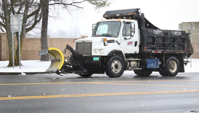 A Tennessee Department of Transportation truck salts Ft. Campbell Boulevard on Tuesday morning as snow continues to fall over most of Middle Tennessee.