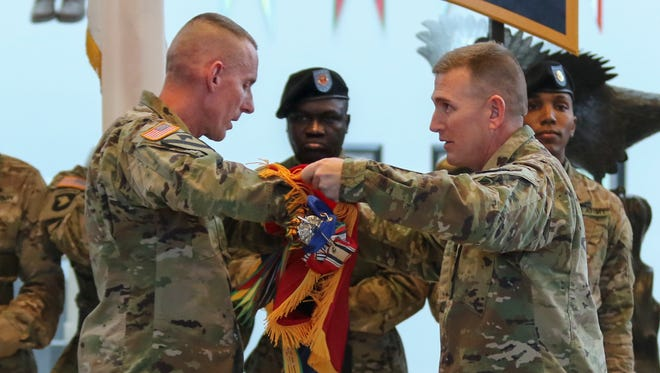 Maj. Gen. Gary Volesky, the commanding general of the 101st Airborne Division and Fort Campbell, left, and Command Sgt. Maj. Gregory Nowak participate in the division color casing ceremony held on Thursday as the 101st Airborne Division prepares to deploy to Iraq in the next couple days.