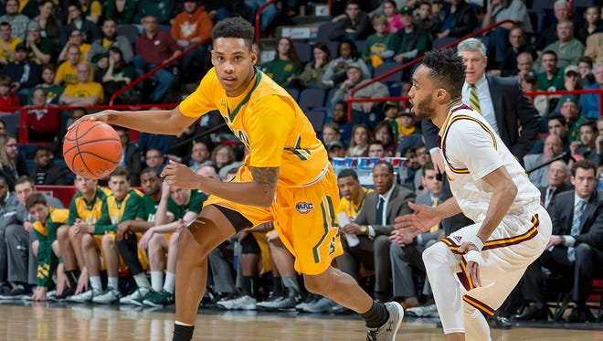 Ibn Muhammad (right) defends Siena during Iona's 81-70 victory in the MAAC tournament semifinals at the Times Union Center on March 6, 2016. Muhammad is questionable for the championship game against Monmouth after suffering a back injury.