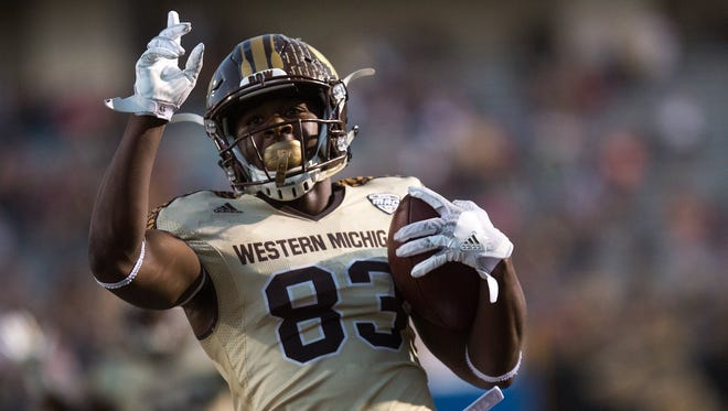 Western Michigan wide receiver Michael Henry scores a touchdown in the first half against Georgia Southern during an NCAA college football game at Waldo Stadium in Kalamazoo.