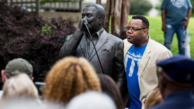 """May 12, 2017 - Rodd Bland, son of the famous blues singer, Bobby """"Blue"""" Bland, stands with the statue of his late father during dedication. The bronze statue of Bobby """"Blue"""" Bland is installed on the MLGW property at the corner of South Main and Dr. Martin Luther King, Jr. Avenue."""