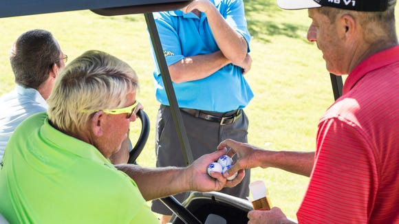 June 04, 2018 - John Daly hands signed balls to Paul
