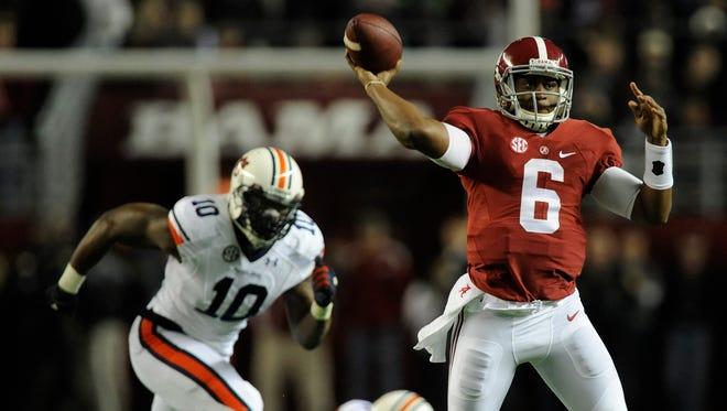 Alabama quarterback Blake Sims throws on the run against Auburn the Iron Bowl at Bryant-Denny Stadium in Tuscaloosa, Ala. on Saturday November 29, 2014.