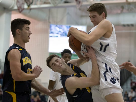 Marlboro's PJ Ringel and Ranney's Chris Autino battle for a rebound during first half action. Toms River North vs Mater Dei in Shore Conference Boys Basketball Semifinal in Toms River on February 21, 2017.