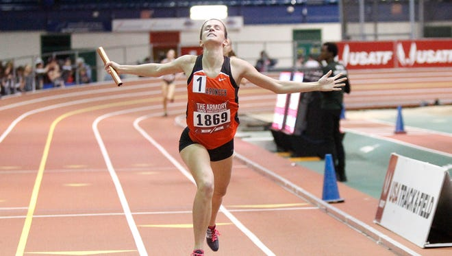 Mamaroneck's Katie DeVore crosses the finish line with a first-place time of 9:01.81 in the 4x800-meter relay at the  Armory Track Invitational on Saturday.
