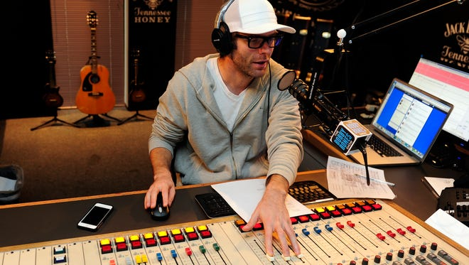 "Nationally syndicated radio host Bobby Bones is the host of ""The Bobby Bones Show"" and works in the Nashville's 98 WSIX radio studio on Tuesday morning on Sept. 17, 2013."