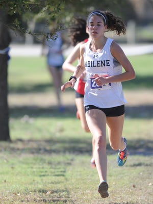 Abilene High senior Ashton Endsley runs in the Class 6A state cross country meet while Houston Lamar's Julia Heymach follows. Heymach passed Endsley in the final 50 yards to win the race in 17:12.78, while Endsley was second in 17:16.15 on Saturday at Old Settlers Park in Round Rock.