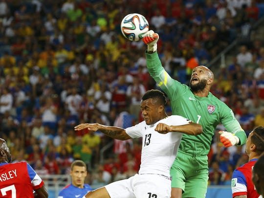U.S. goalkeeper Tim Howard, a North Brunswick graduate, knocks the ball away from Ghana's Jordan Ayew during the 2014 World Cup in Brazil.