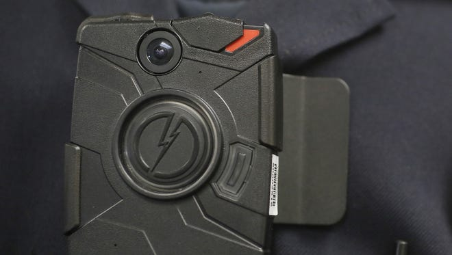 A police body camera is shown during a demonstration. The city of Alexandria will obtain body cameras for its police officers.