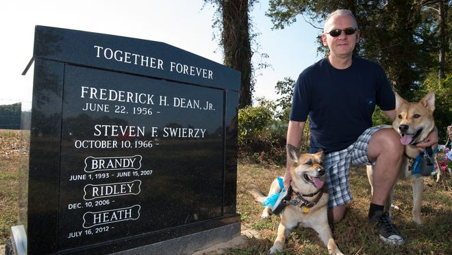 Steven Swierzy, with his dogs Heath (left) and Ridley, has a burial site at Henlopen Memorial Park in Milton for him and his husband, Frederick Dean Jr., as well as for their pets. Many states expressly bar burying pets in human cemeteries, but Delaware law is silent on the matter.