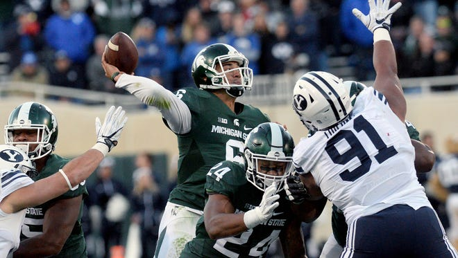 Michigan State University  junior quarterback Damion Terry (6) throws a pass in the second half of MSU's game against BYU Saturday, October 8, 2016 in East Lansing.