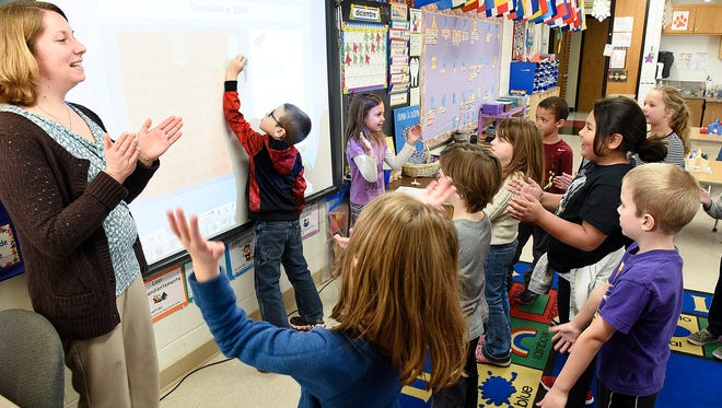 Teacher Kari McRaith plays a game in her first-grade Spanish immersion class teaching students to count by two Thursday, Dec. 15, at Clearview Elementary School in Clear Lake.