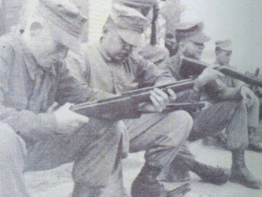 Lee Harvey Oswald, third from left, sits with his rifle beside Evansville man Gary L. Bullock, left, at Marine boot camp in 1956. Six Evansville men were in boot camp with Oswald.