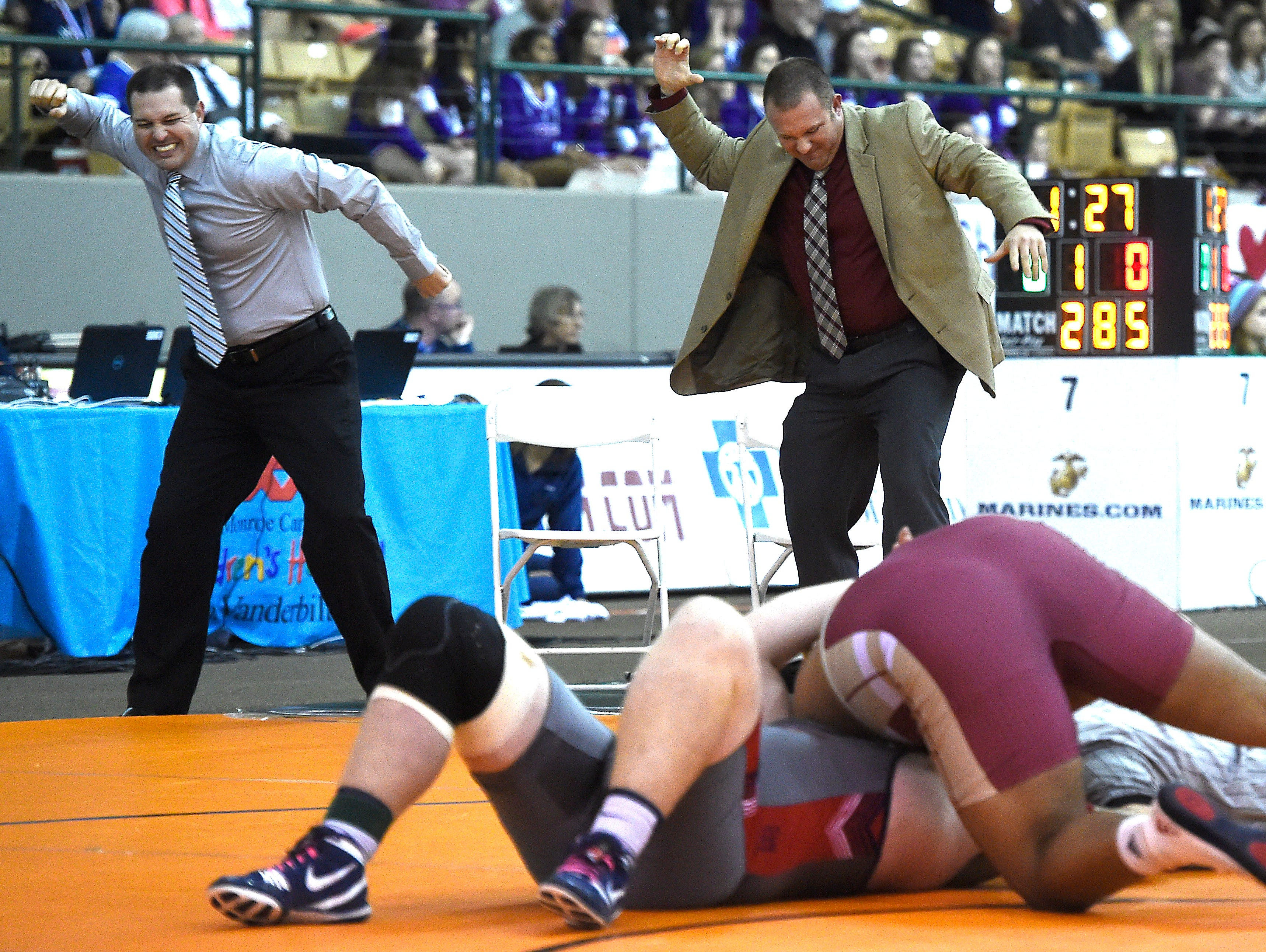 Riverdale coaches including Shawn Jones, right, celebrate before the pin is finished as they knew Nick Boykin (Riverdale) was going to defeat Logan Townsend (Jefferson Co.) at the TSSAA state wrestling championships Saturday Feb. 20, 2016, in Franklin, Tenn.
