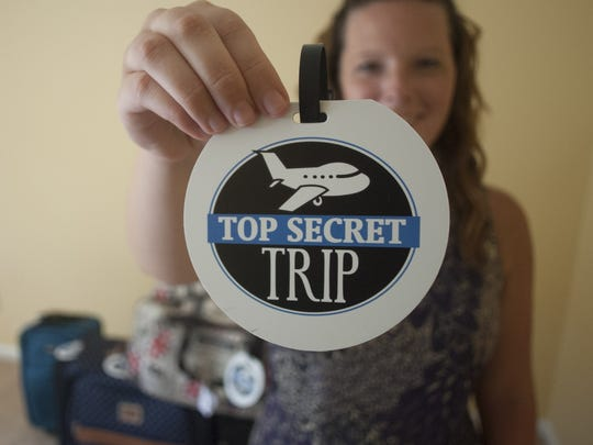 Katie Miller shows a logo of her business Top Secret