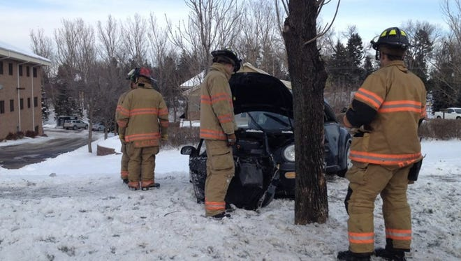 A woman was injured after her car struck a tree on Minnesota Avenue near Sunnymeade Lane, just south of 57th Street.