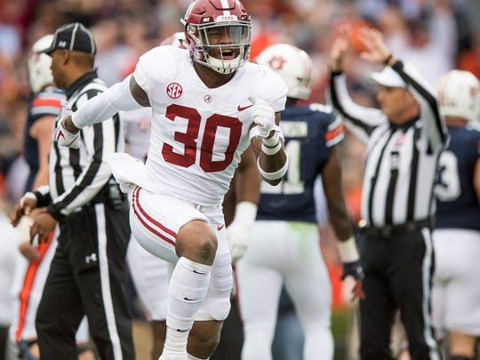 Alabama linebacker Mack Wilson (30) celebrates recovering an Auburn fumble in first half action in the Iron Bowl in Auburn, Ala. on Saturday November 25, 2017. (Mickey Welsh / Montgomery Advertiser)