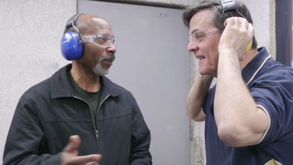 Teachers Christopher Bates, left, and Jon Altmann talk school safety at Caswells Shooting Range in Mesa.