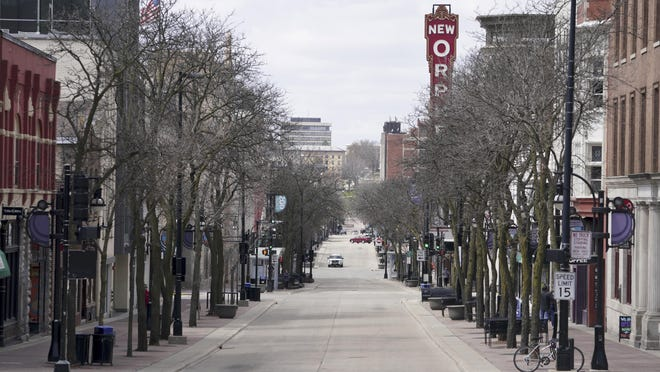 In a familiar scene during the pandemic lockdowns of 2020 across the U.S., State Street in Madison, Wisconsin, was mostly empty during a spring Wednesday.