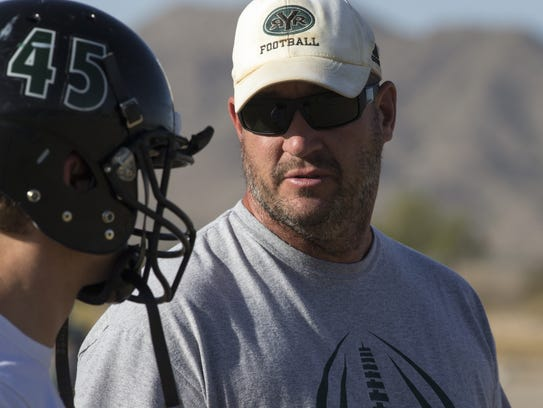 Youngker coach Tony Cluff talks with a player on Monday.