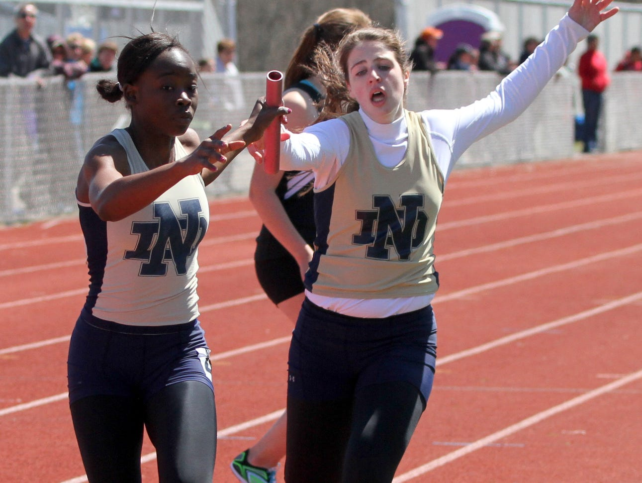 Deb Diarra takes the baton for Notre Dame during a win in the 3,200 relay earlier this season at the Waite-Molnar Invitational at Ernie Davis Academy. The Crusaders will try for their third straight girls Large School title on Thursday and Friday at Trumansburg High School.