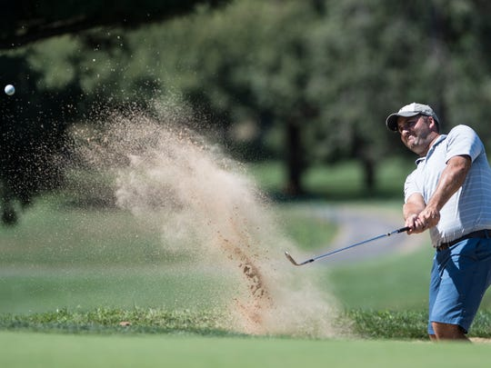 Mike Turner blasts out of a bunker at the annual Lebanon County Better Ball Tournament on Sunday.