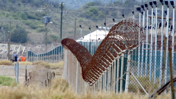 Razor wire tops one of the several fences surrounding