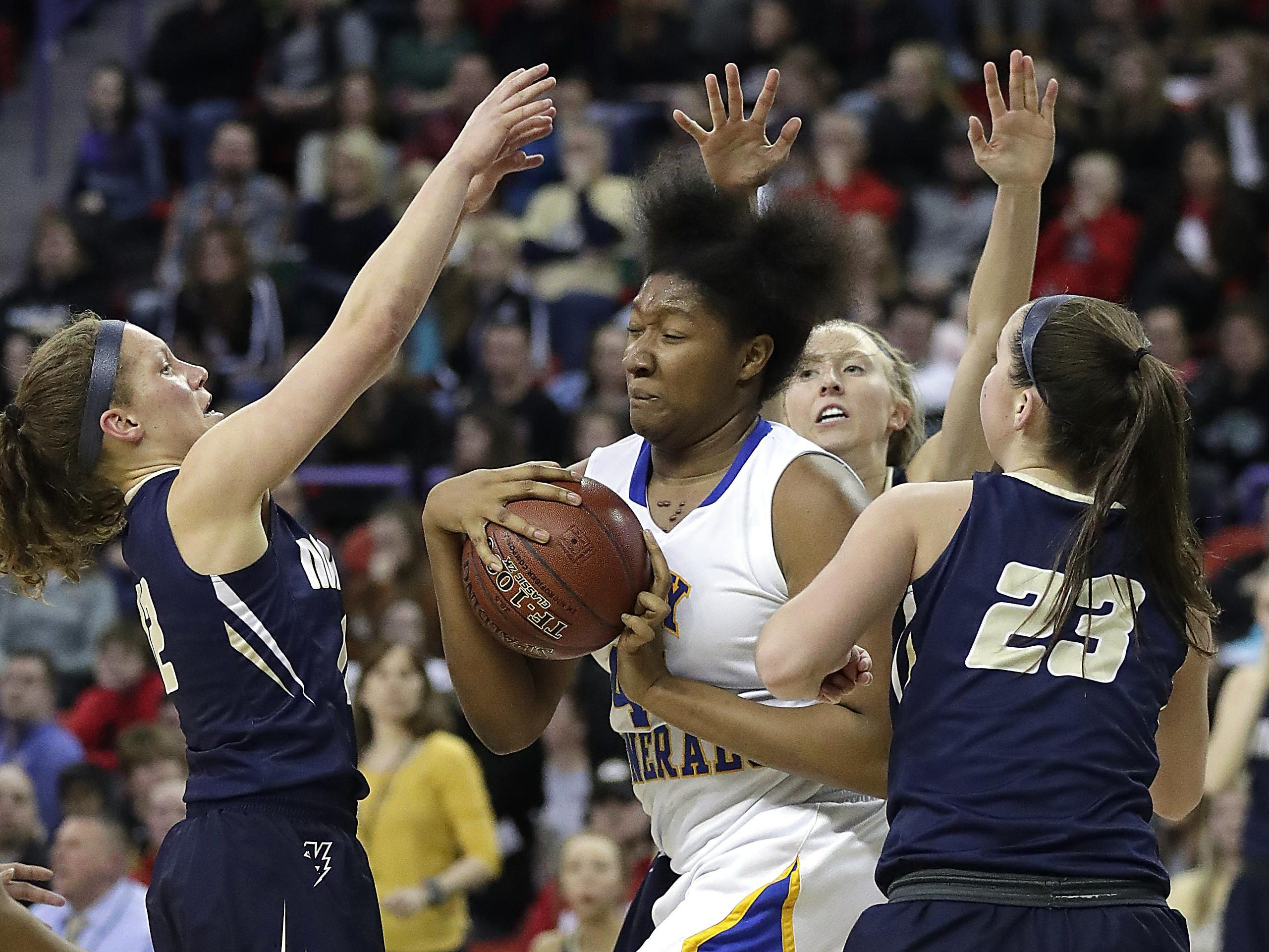 Appleton North's Callie Pohlman, Paige Schabo and Kalen Klitzke surround Milwaukee King center Sydnee Roby under the basket in the WIAA Girls State Basketball Division 1 semifinal at the Resch Center in Ashwaubenon Friday.