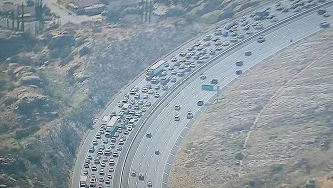 Traffic was backed up along Highway 118 east of Simi Valley Tuesday afternoon as two brush fires burned nearby.