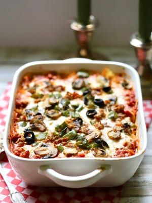 Easy Supreme Pizza Casserole is full of lots of melted cheese, spicy Italian sausage, crisp bell pepper, earthy mushrooms, sliced black olives and pepperoni.