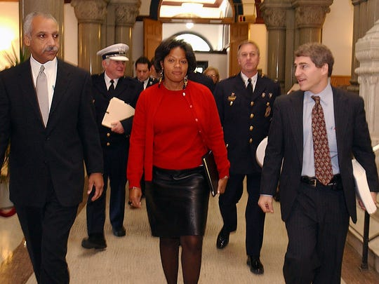 Friday November 14, 2003: PROFILINGSTUDY-METRO: (l-r) Court appointed monitor Saul Green, Cincinnati FOP President Roger Webster, Cincinnati City manager Valerie Lemmie, Cincinnati Police Chief Tom Streicher and deputy court appointed monitor John E. Eck walk towards room 115 at City Hall for the public release of the findings of the racial profiling study Friday morning. Photo by Glenn Hartong/The Cincinnati Enquirer. gh.