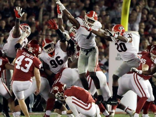 Georgia linebacker Lorenzo Carter (7) blocks a field goal attempted by Oklahoma kicker Austin Seibert (43) during overtime in the Rose Bowl NCAA college football game, Monday, Jan. 1, 2018, in Pasadena, Calif. Georgia won 54-48. (AP Photo/Gregory Bull)