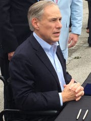 Texas Gov. Greg Abbott meets with reporters in Austin