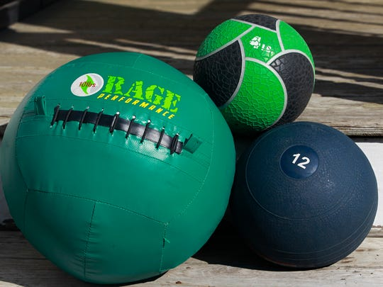 Types of medicine balls from left, wall ball, hard-sided, center and soft-sided.