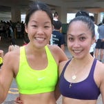 Manami Iijima, left, and Rhea Macaluso finished first and second overall in the female division of the Academy of Our Lady of Guam's 14th Annual Fund Run Race/Walk on Jan. 16. Iijima finished in 18 minutes and 28 seconds, while Macaluso came in at 20:53.