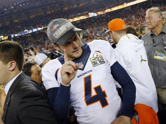 Denver Broncos' Britton Colquitt (4) leaves the field after winning the NFL Super Bowl 50 football game against the Carolina Panthers Sunday, Feb. 7, 2016, in Santa Clara, Calif. The Broncos won 24-10. The Broncos won 24-10. (AP Photo/Matt York)