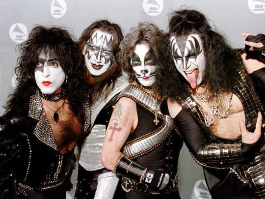 "Members of the veteran rock group ""KISS"" pose for photographers in the photo room at the 38th Annual Grammy Awards in Los Angeles."