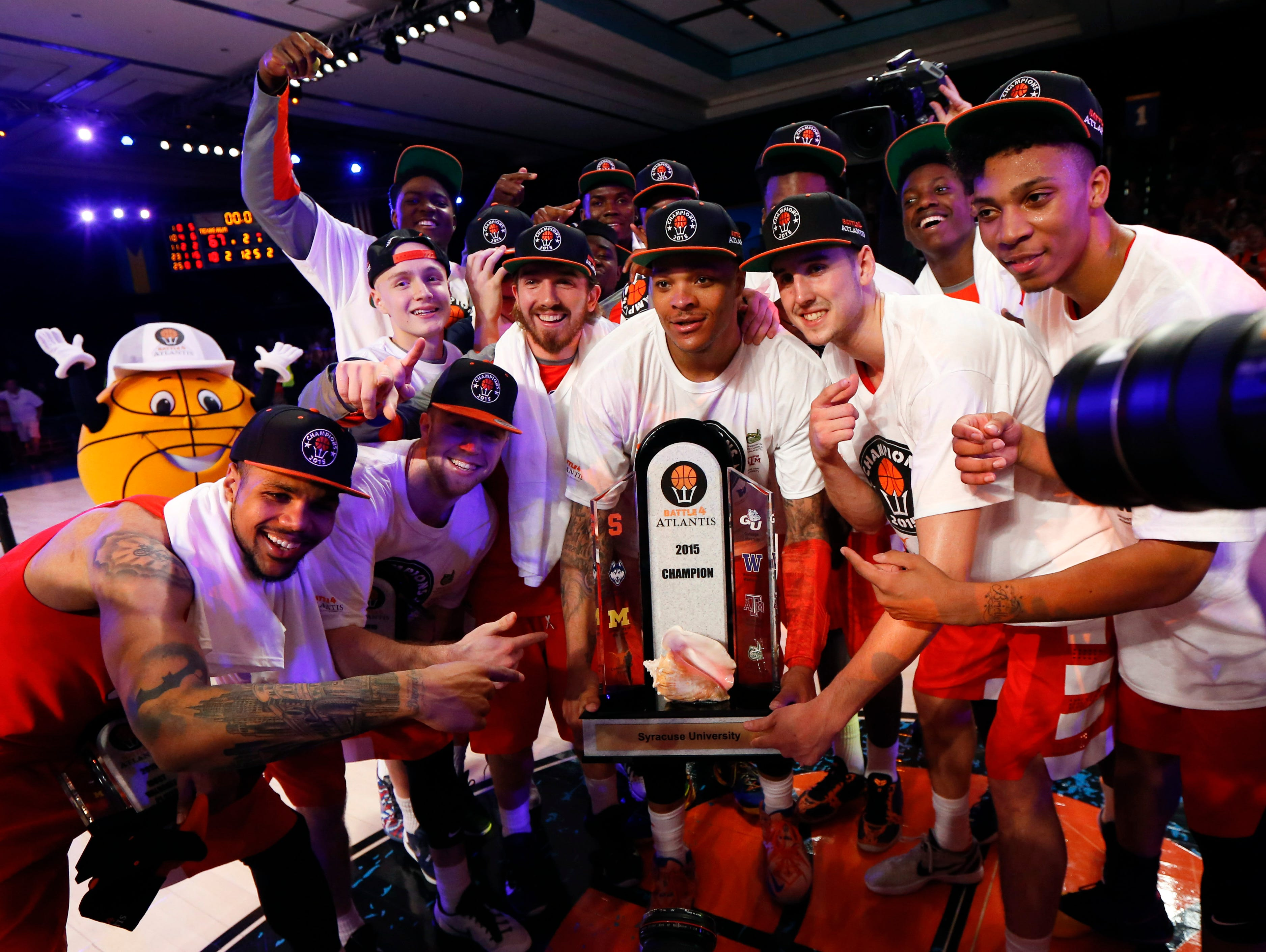 Syracuse Orange players celebrate winning the championship against the Texas A&M Aggies in the 2015 Battle 4 Atlantis championship.