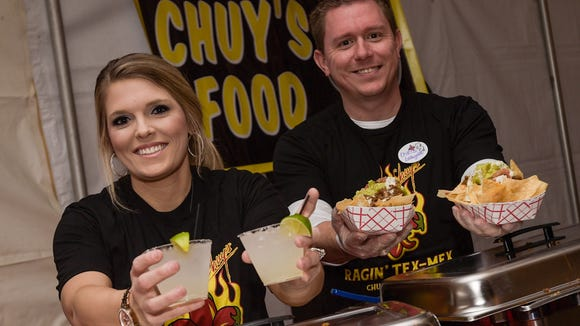 Tonya Smith and Chris Creeden serving up Nachos and Margaritas at Chuy's preview night.  This is a  first look into one of the new businesses opening in the Ambassador Town Center anchored by Costco.