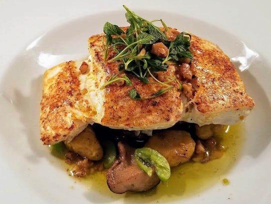 Brined swordfish is served over butternut squash gnocchi