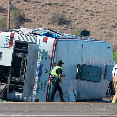 Emergency personnel work at the scene of a deadly multivehicle