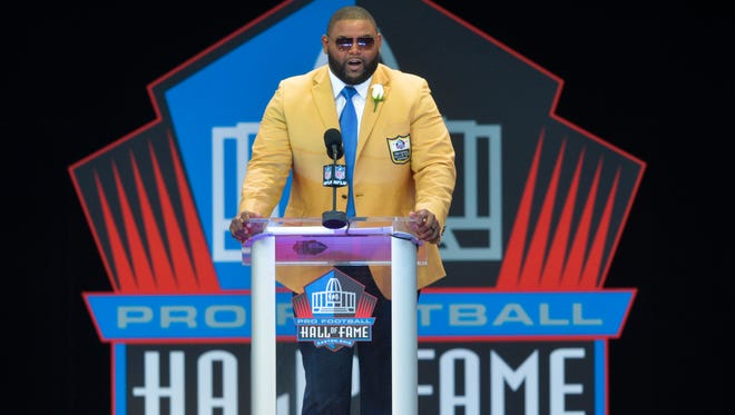 Former NFL player Orlando Pace delivers his speech during an induction ceremony at the Pro Football Hall of Fame Saturday, Aug. 6, 2016, in Canton, Ohio. (AP Photo/David Richard)