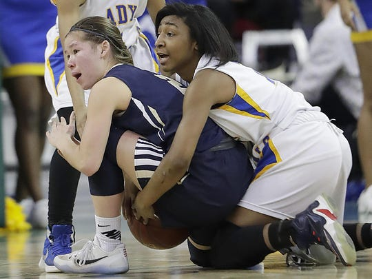 Appleton North's Kari Brekke, left, tries to call a timeout on a loose ball against Milwaukee King's Aleah Herron on Friday in Ashwaubenon.