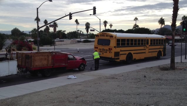 The driver of a Toyota pickup fled after hitting a school bus Tuesday in Rancho Mirage. A suspect was arrested in Cathedral City, officials said.