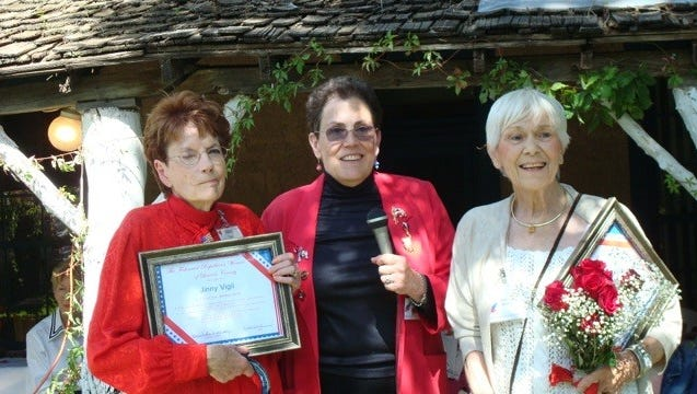 Marci Butchofsky, President of the FRWLC presented Life Time Membership Awards to Dolores Stevens, left, and Jinny Vigil, right.