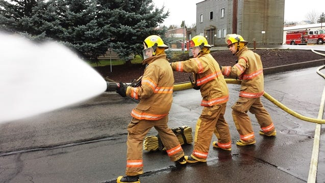Recruits learn how to flow water through a 2 ½ inch hose.