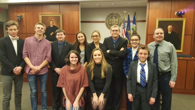 Spring Grove Area High School mock trial team members pose for a photo with teach-coach Jason Baker and attorney-coach Jonathan Blake.