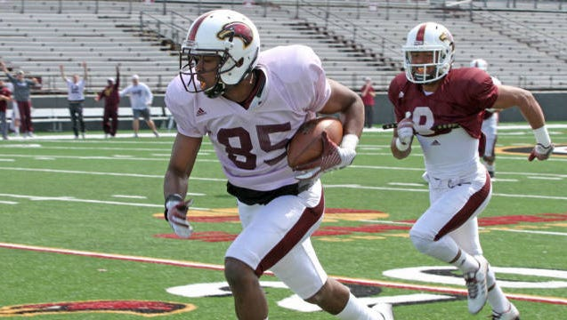 ULM practiced in helmets and shoulder pads for the first time this spring on Tuesday.