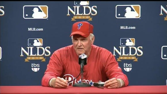 Charlie Manuel answers a question during a press conference